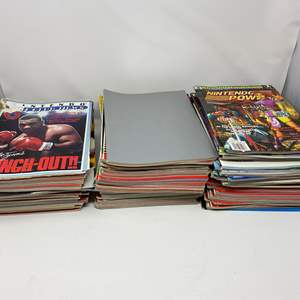 Lot # 230 - Awesome Collection of Vintage Nintendo Power Magazines & Strategy Guides - (See Pictures)