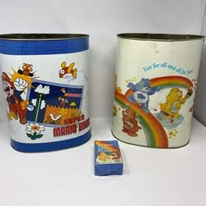 Lot # 237 - Vintage Tin Mario Bros. Trashcan, Vintage Tin Care Bears Trashcan, Vintage Care Bears Band-Aids