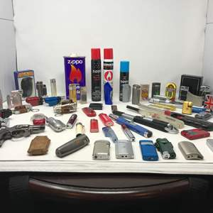Lot # 107 - Nice Selection of Vintage Lighters & Fuel