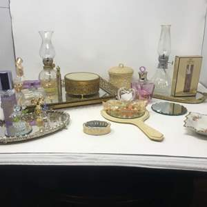 Lot # 113 - Vintage Mirrored Vanity Trays, Powder Box, Hand Mirror, Perfumes, Oil Lamps & More..