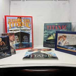 Lot # 143 - Collection of Titanic Movies & Books - (Movies Are New in Box)
