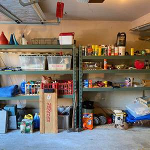 Lot # 399 - Two Heavy Duty Metal Shelving Units Filled w/ Tools, Chemicals, Tiedowns, Vintage Coleman Lantern, Hardware & More