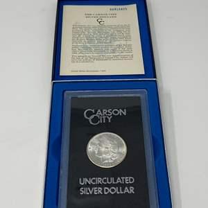 Lot # 6 - 1884 Uncirculated Carson City Morgan Silver Dollar