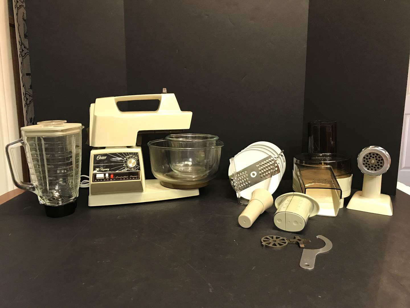 Lot # 61 - Oster Kitchen Center w/Attachments  (main image)