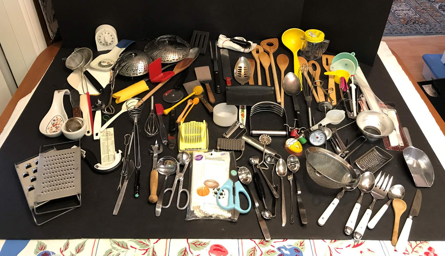 Lot # 63 - Lot of Kitchen Implements: Wood & Plastic Spoons, Candy Thermometer, Spatulas, Cheese Graders & More (main image)