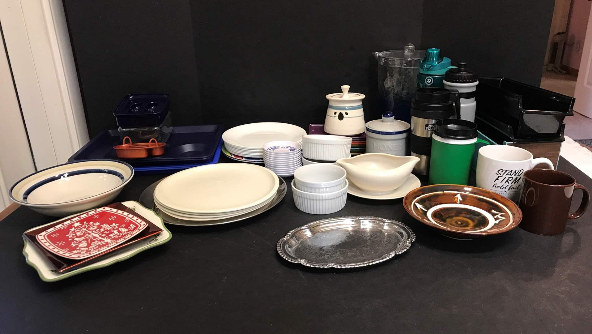 Lot # 76 - Lot of Misc. Kitchen Items: Corelle Plates, Plastic Plates & Water Bottles, Bowls & More  (main image)
