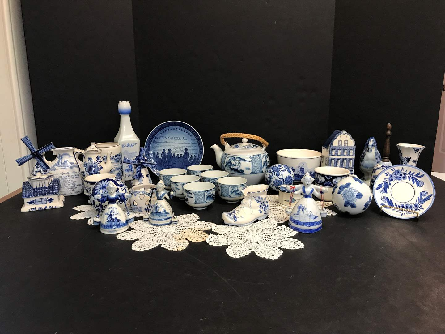 Lot # 81 - Beautiful Collection of Delfts Blue Items: Bells, Tea Pot, Windmill, Plates, Small Dishes & More  (main image)