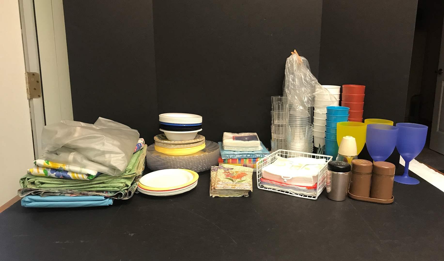 Lot # 86 - Plastic Cups, Plates, Paper Napkins & Table Clothes  (main image)