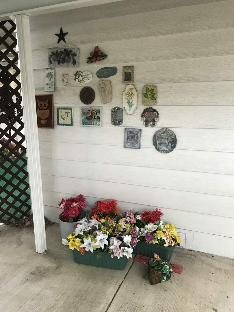 Lot # 267- Outdoor Wall Décor & Planters w/Faux Plants (main image)