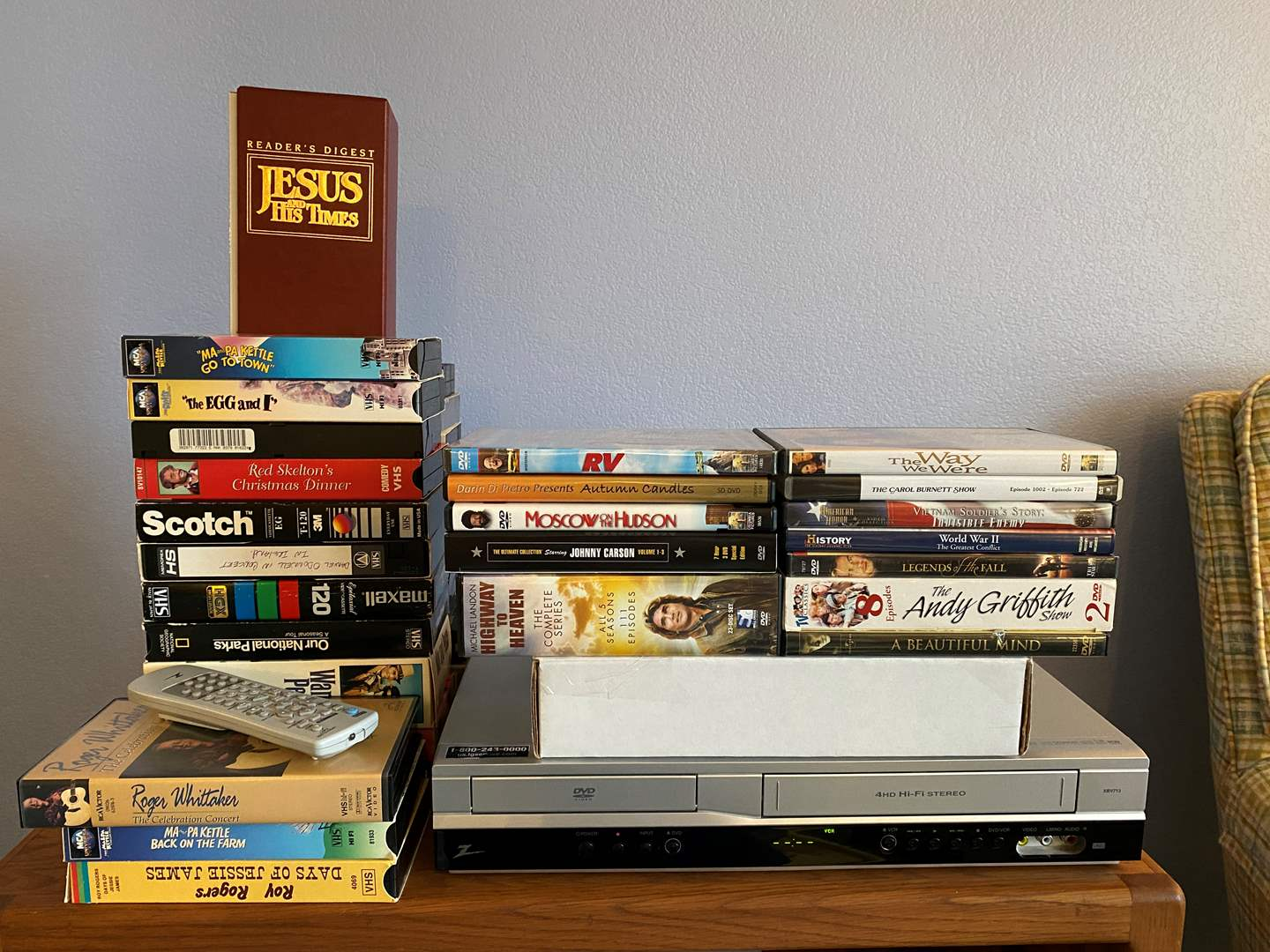 Lot # 20 - Zenith DVD/VHS Player w/ Selection of DVD's & VHS Tapes - (Works) (main image)