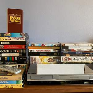 Lot # 20 - Zenith DVD/VHS Player w/ Selection of DVD's & VHS Tapes - (Works)