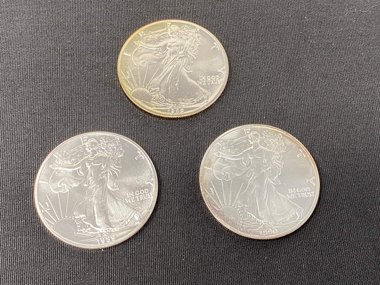 Lot # 107 - Three 1 oz. Silver American Eagle Dollars (main image)