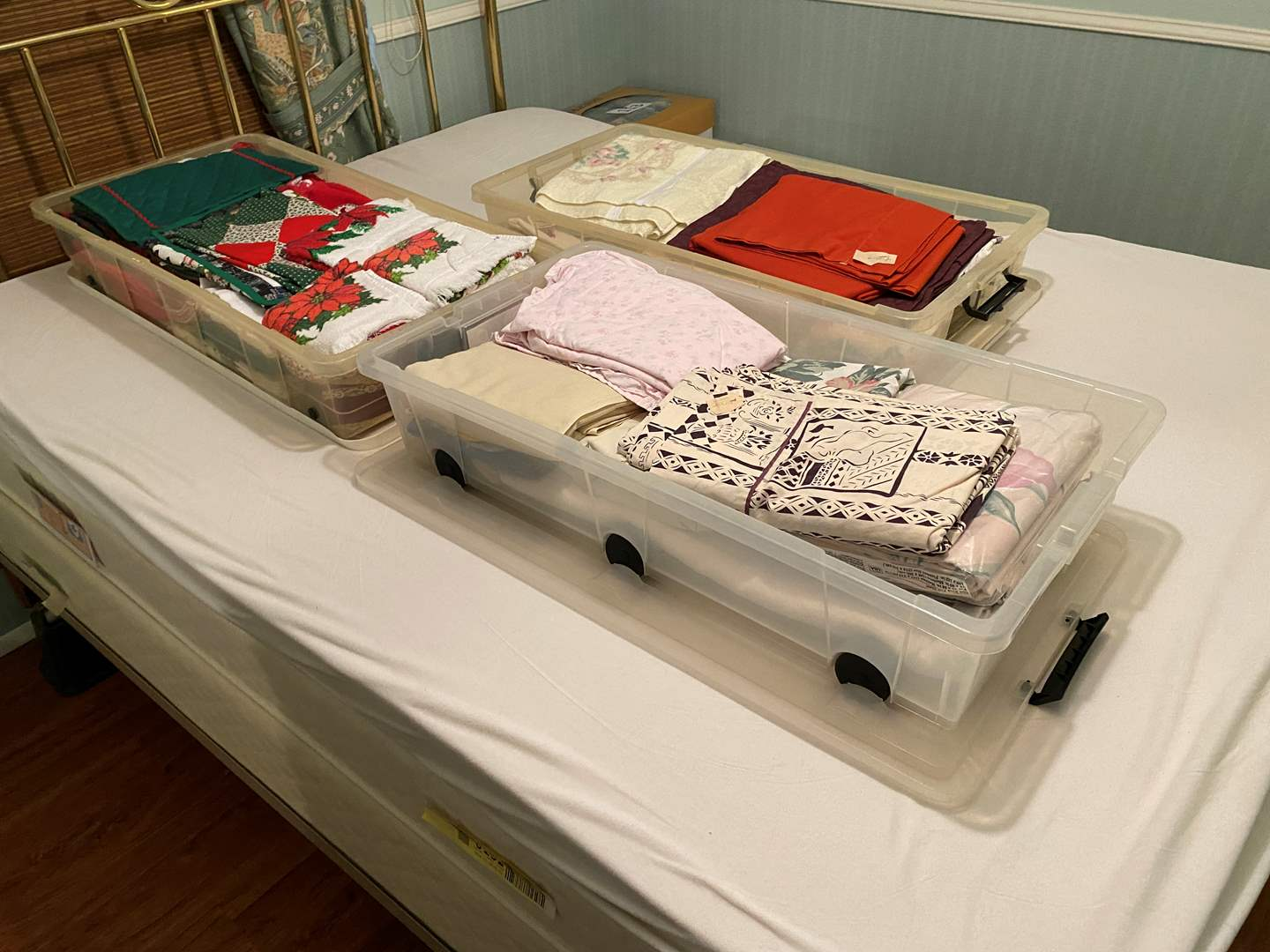Lot # 114 - Three Bins of New & Used Bedding, Towels, Kitchen Towels, Xmas & More (main image)