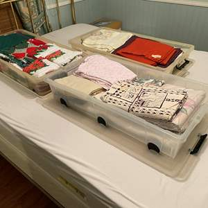 Lot # 114 - Three Bins of New & Used Bedding, Towels, Kitchen Towels, Xmas & More