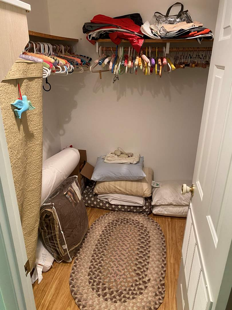 Lot # 170 - Closet Full of Bedding, Shoes, Hats, Hangers & More (main image)