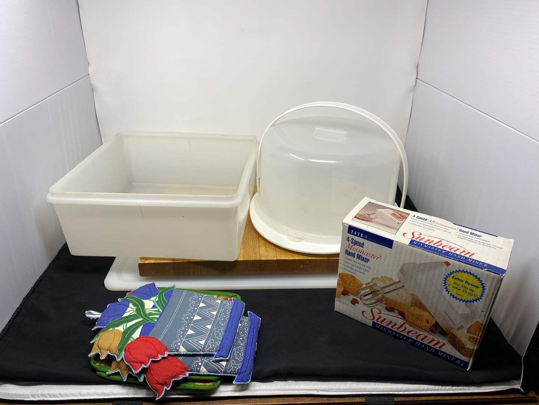 Lot # 222 - Like New Sunbeam Hand Mixer, Two Cutting Boards, Cake Tray & Tupperware (main image)