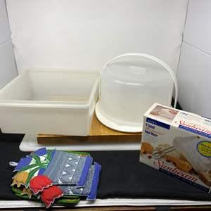 Lot # 222 - Like New Sunbeam Hand Mixer, Two Cutting Boards, Cake Tray & Tupperware