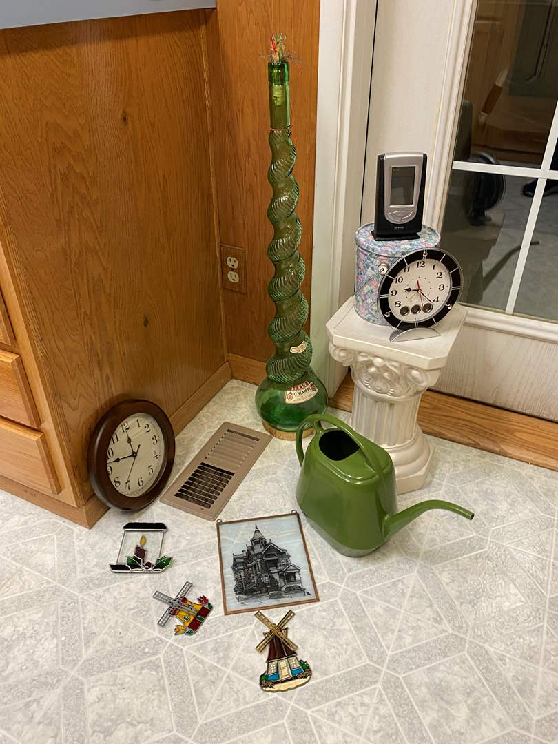 Lot # 223 - Stained Glass Window Hangings, Tall Vintage Glass Decanter, Clocks, Ceramic Stand & More (main image)