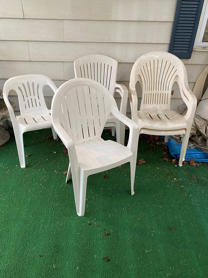 Lot # 261 - Six Plastic Patio Chairs (main image)