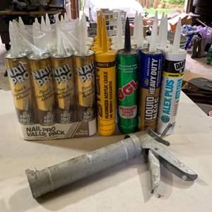 Lot # 122 Calk (31 tubes) with Caulking Gun