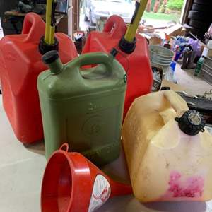 Lot # 123 Gas Cans (4) & Funnel