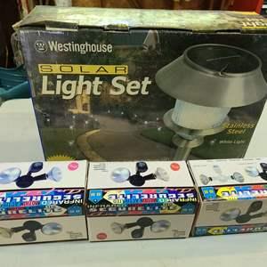 Lot # 249 Stainless Steel Solar Light Set & Security Lights