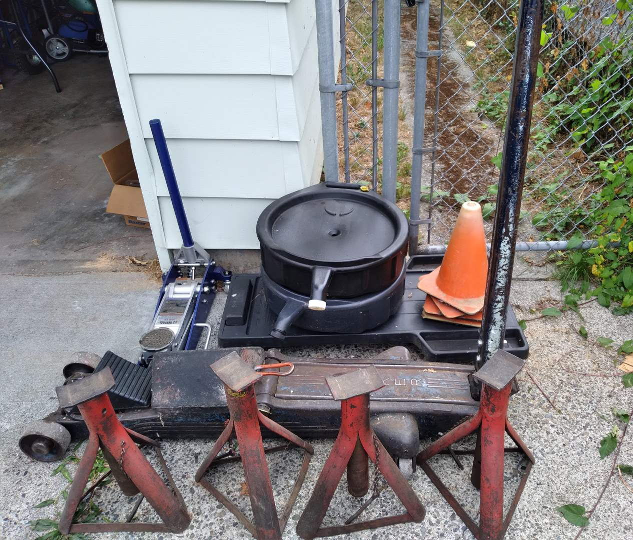 Lot # 76 - Jack Stands, Two Floor Jacks, Roller Board Creeper, Cones, and Drain Pans (main image)