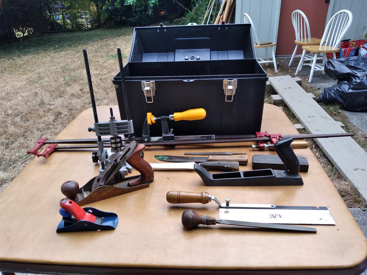 Lot # 82 - Toolbox with Planes, Guides, Variety of Clamps and Vintage Hand Saw and Planer (main image)