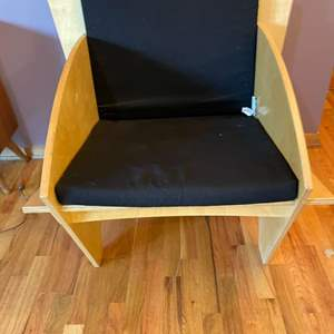 Lot # 16 - Unusual Chair (Light Wood and Black Cushions)