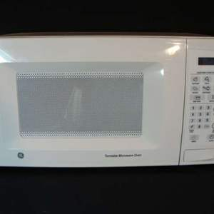Lot # 99 - GE Small Turntable Microwave Oven