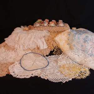 Lot # 114 - Thirty One (31) Table cloths and Doilies (w/Crocheted Teacups)