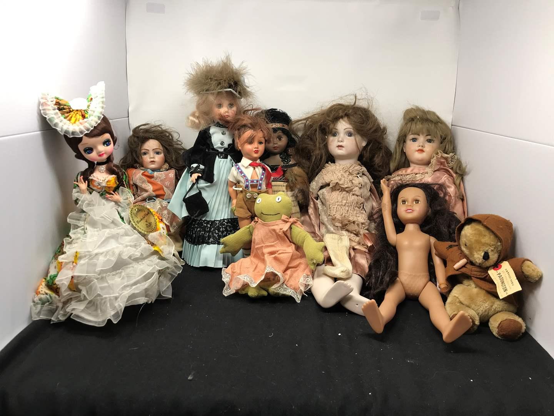 Lot # 157 - 2 Large Articulating Dolls, Plastic Dolls & Stuffed Paddington Bear  (main image)