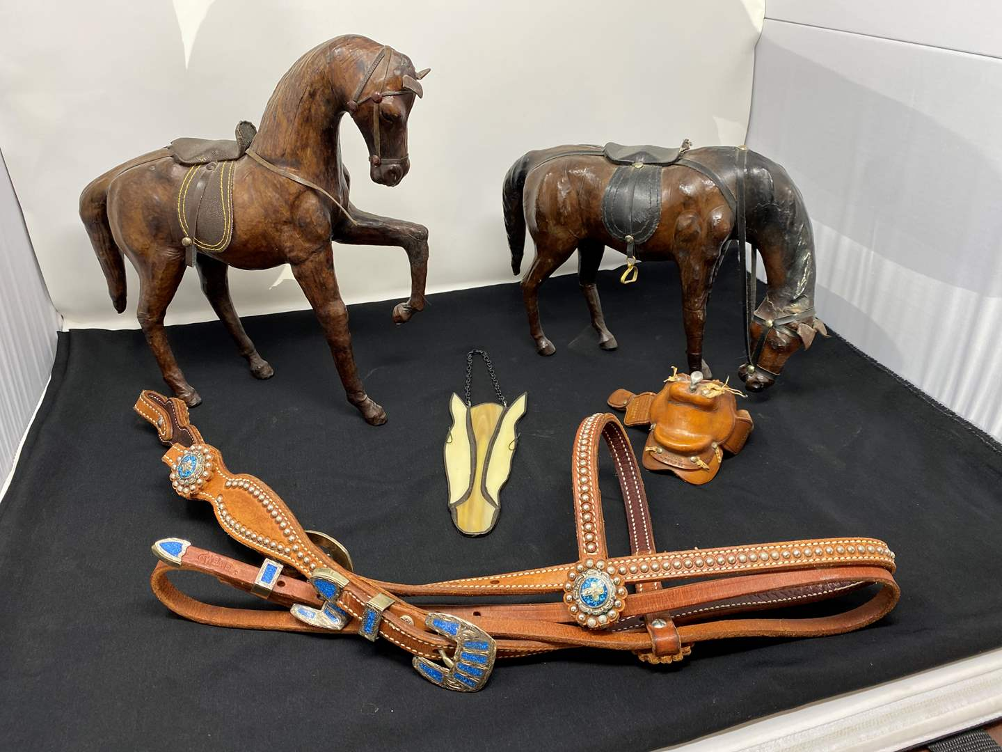 Lot # 3 - Two Leather Horses, New Leather Horse Reins, Small Leather Saddle, Stained Glass Horse Head. (main image)