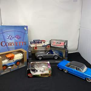Lot # 7 - New in Box Diecast Cars, Hardcover Corvette Book & More