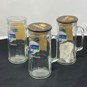 Lot # 50 - Three Vintage Fisher Peanuts Glass Seahawks Mugs