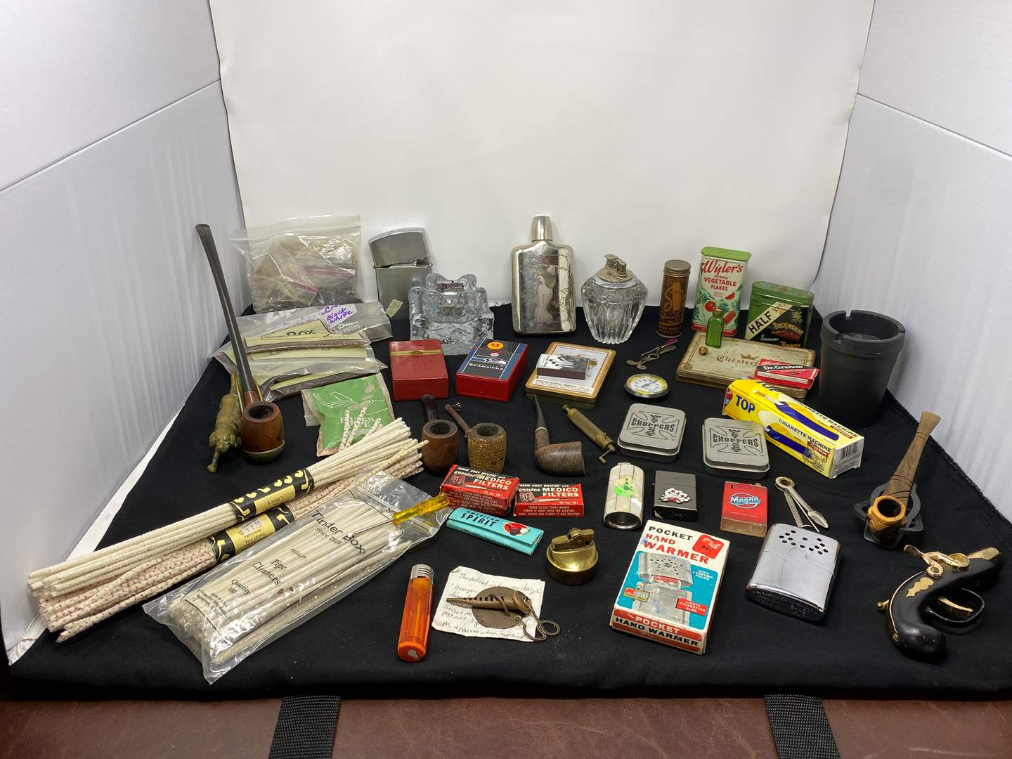 Lot # 62 - Tobacco Pipes, Smoking Accessories, Hand Warmers, Lighters, & More (main image)