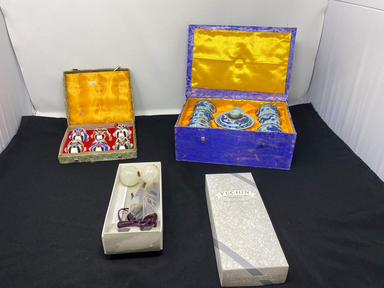 Lot # 64 - Small Asian Tea Set, Small Asian Ceramic Masks, Onyx Tassels  (main image)