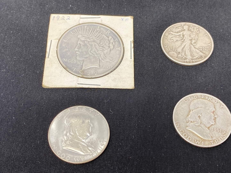 Lot # 97 - 1922 Peace Dollar, 1943 Walking Liberty Half Dollar, '48 & '51 Franklin Half Dollars (main image)