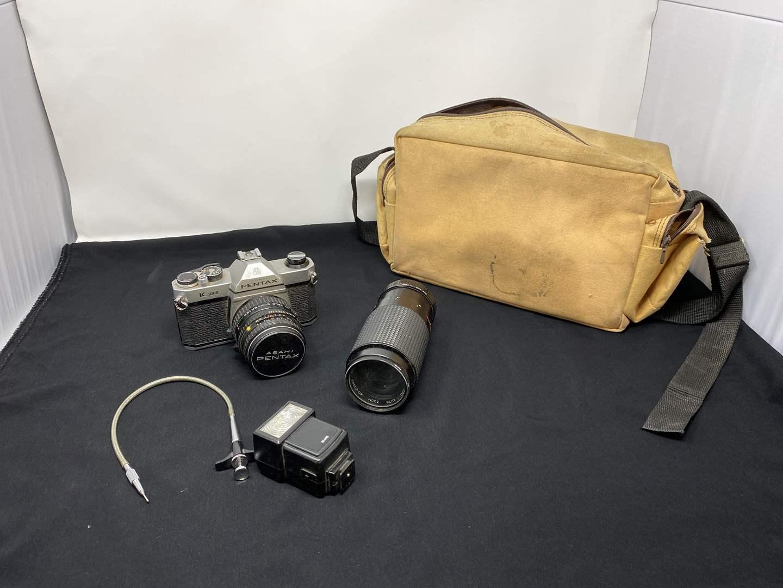 Lot # 130 - Vintage Pentax K1000 camera w/ Lens & Case (main image)