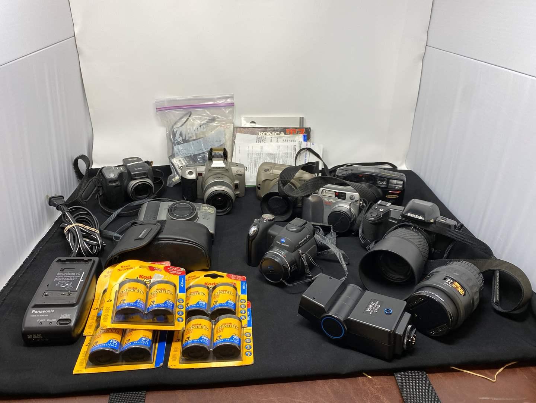 Lot # 131 - Collection of Vintage Minolta, Kodak, & Pentax Cameras  (main image)