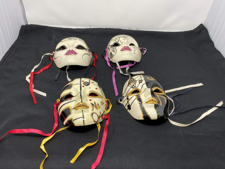 Lot # 138 - Four Signed Masquerade Masks (main image)