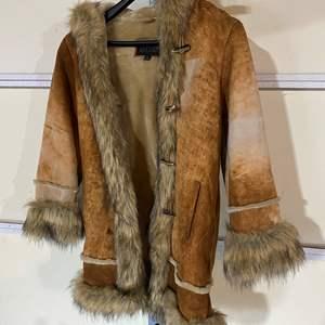 Lot # 192 - Pelle Studio Wilsons Leather Woman's Coat - (Size Medium)