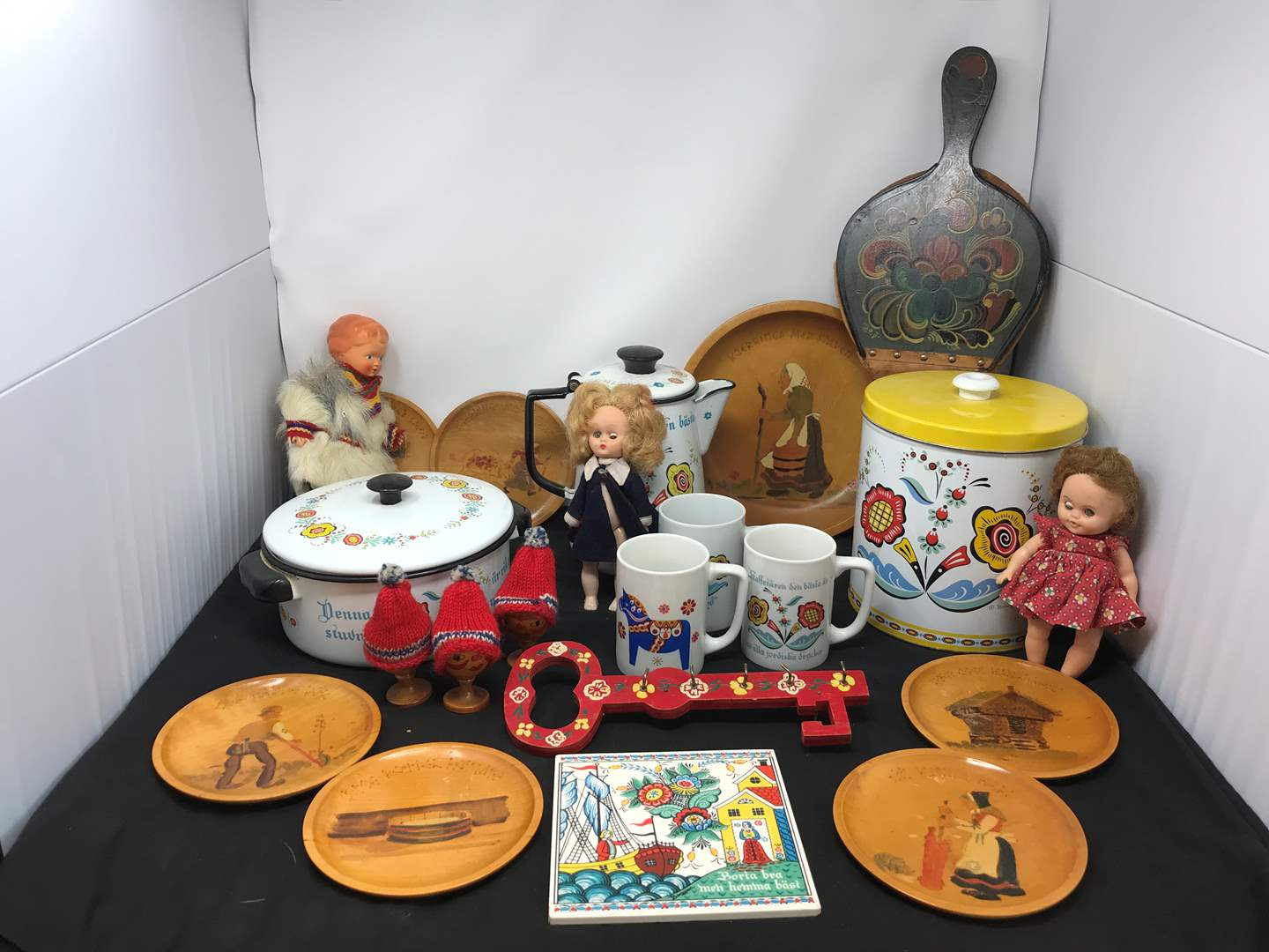 Lot # 50 - Lot of Norwegian Items: Canister, Doll, Wood Plates Coffee Mugs & More (main image)