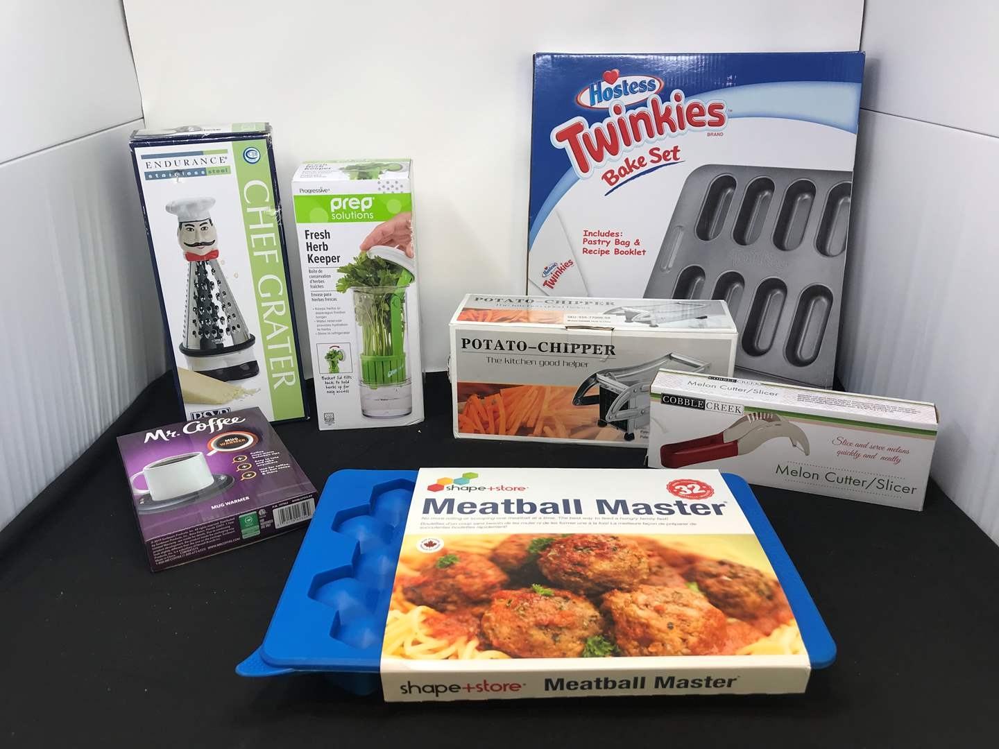 Lot # 78 - Lot of New Items: Meat Ball Master, Twinkies Bake Set, Fresh Herb Keeper & More (main image)
