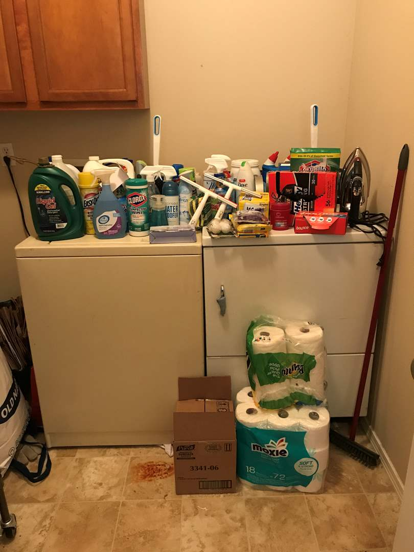 Lot # 98 - Large Lot of New & Used Cleaning Solutions, Toilet Paper, Iron & Ironing Board (main image)