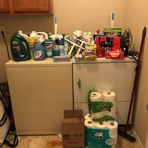 Lot # 98 - Large Lot of New & Used Cleaning Solutions, Toilet Paper, Iron & Ironing Board