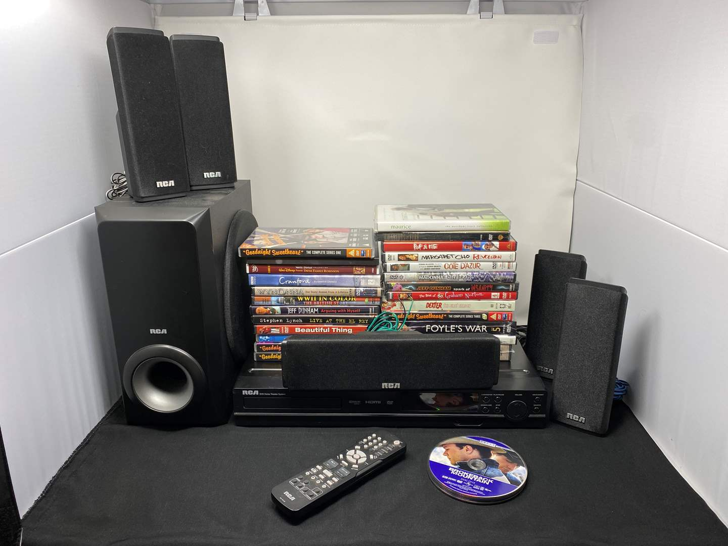 Lot # 10 - RCA DVD Home Theater System w/ Collection of DVD'S - (Powers On) (main image)