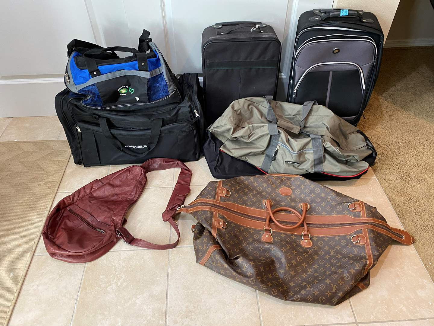 Lot # 116 - Louis Vuitton Duffel, Carry-On Size Luggage & Other Duffel Bags (main image)