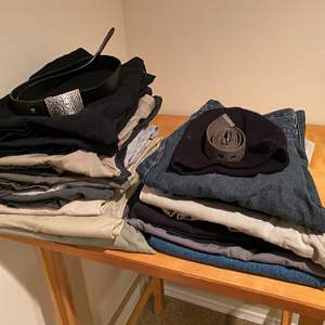 Lot # 131 - Stack of Men's Pants - (See Pictures for Sizes)