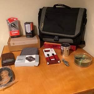 Lot # 146 - NIB Items: Phone Soap Pro, Jabra Bluetooth Headset, TV Wall Mount, Targus Laptop Bag, Blackberry Speaker & More